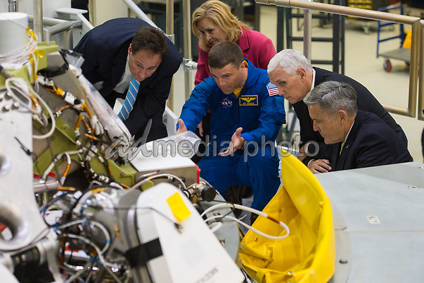 In this photo released by the National Aeronautics and Space Administration (NASA) United States Vice President Mike Pence, second from right; NASA Acting Administrator Robert Lightfoot, left; Deputy Director, Kennedy Space Center, Janet Petro, second from left; NASA astronaut Reid Wiseman, center; and Director, Kennedy Space Center (KSC), Robert Cabana, right, look at the Orion capsule that will fly on the first integrated flight with the Space Launch System rocket in 2019, during a tour of the Kennedy Space Center's (KSC) Operations and Checkout Building on Thursday, July 6, 2017 in Cape Canaveral, Florida. Photo Credit: Aubrey Gemignani/NASA/CNP/AdMedia
