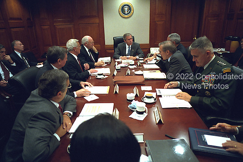 United States President George W. Bush meets with the National Security Council (NSC) in the Situation Room in the morning of Thursday, September 20, 2001. Photographed with the President are, from left to right, Federal Bureau of Investigation (FBI) Director Robert Mueller, Vice President Cheney's Chief of Staff Lewis Libby, Central Intelligence Agency (CIA) Director George Tenet, U.S. Attorney General John Ashcroft, U.S. Secretary of the Treasury Paul O'Neill..Mandatory Credit: Eric Draper - White House via CNP.