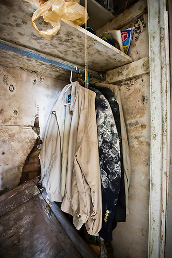 The closet of a home in the Lakeview area that suffered major damage due to Hurricane Katrina flooding in New Orleans, Louisiana. Many of these homes' interiors like this one remain untouched; floors are covered in flood debris and rubble while the walls and surfaces are still scab-covered layers of mold.