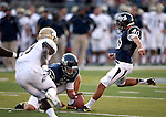 Nevada's Chase Tenpenny holds for Brent Zuzo during the first half of a college football game in Reno, Nev., on Saturday, Sept. 7, 2013. (AP Photo/Cathleen Allison)