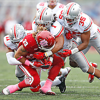 Ohio State Buckeyes safety Vonn Bell (11), Ohio State Buckeyes safety Erick Smith (1) and Ohio State Buckeyes linebacker Chris Worley (35) combine to stop Indiana Hoosiers running back Ricky Brookins (33) in the second half at Memorial Stadium on October 3, 2015. (Chris Russell/Dispatch Photo)