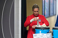 , FL - : Ashlyn Harris #18 of the United States tapes up during a game between  at  on ,  in , Florida.