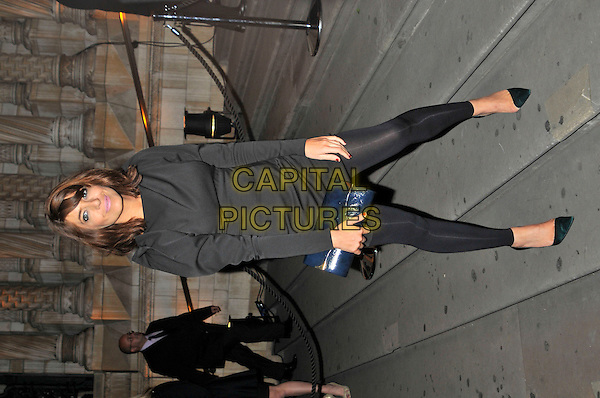 CLAUDIA WINKLEMAN.The 30 Days of Fashion And Beauty Gala Party, at the Natural History Museum, London, England..September 21st, 2009.full length black top leggings blue clutch bag .CAP/PL.©Phil Loftus/Capital Pictures.