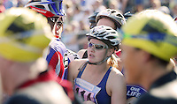 11 AUG 2007 - NOTTINGHAM, UK - A competitor waits to tag her teams last swimmer - British Club Relay Triathlon Championships. (PHOTO (C) NIGEL FARROW)
