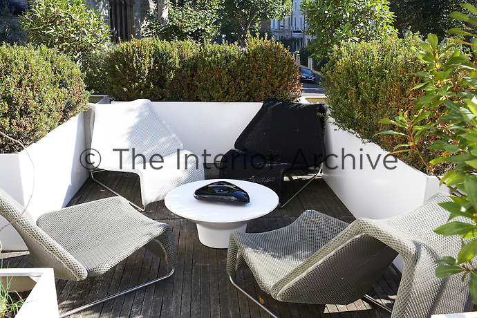 The sunlit roof terrace is furnished with monochrome B&B Italia chairs