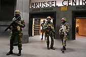 One week after the Paris attacks, soldiers and police patrol the centre of Brussels while the city is under a security lockdown to hunt for terror suspects.