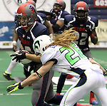 SIOUX FALLS, SD - FEBRUARY 21:  Judd Harrold #20 from the Sioux Falls Storm looks to get past Kane Elenburg #26 from the Nebraska Danger in the first quarter of their game Friday night at the Sioux Falls Arena. (Photo by Dave Eggen/Inertia)