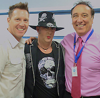 Boy George (Culture Club) poses with Rob Lamarr (Channel 5 presenter)(left) and Tony Perry (Showbiz XI director)(Right) during Showbiz XI v Tesco Online Charity Football Match at Maidstone Football Club, England on 22 September 2013. Photo by Andy Rowland.