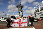 30th September 2017, Riverside Stadium, Middlesbrough, England; EFL Championship football, Middlesbrough versus Brentford; Middlesbrough fans outside the Riverside Stadium with a flag underneath the statue of George Hardwick
