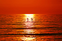 May 15, 2014 - San Diego, California, USA - Paddleboarders glide across the ocean as smoke from recent wildfires in San Diego County creates an orange sunset. (Photo Credit: © K.C. ALFRED/ZUMA PRESS)
