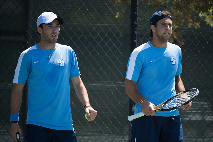 April 25, 2013; San Diego, CA, USA; San Diego Toreros players Ciaran Fitzgerald (left) and Victor Pugliese (right) during the WCC Tennis Championships at Barnes Tennis Center.