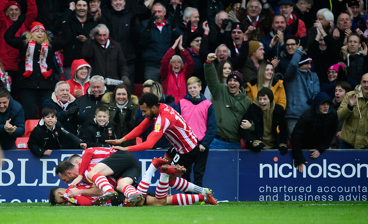 Lincoln City's Kellan Gordon celebrates scoring the opening goal with team-mates<br /> <br /> Photographer Chris Vaughan/CameraSport<br /> <br /> The EFL Sky Bet League Two - Lincoln City v Mansfield Town - Saturday 24th November 2018 - Sincil Bank - Lincoln<br /> <br /> World Copyright © 2018 CameraSport. All rights reserved. 43 Linden Ave. Countesthorpe. Leicester. England. LE8 5PG - Tel: +44 (0) 116 277 4147 - admin@camerasport.com - www.camerasport.com