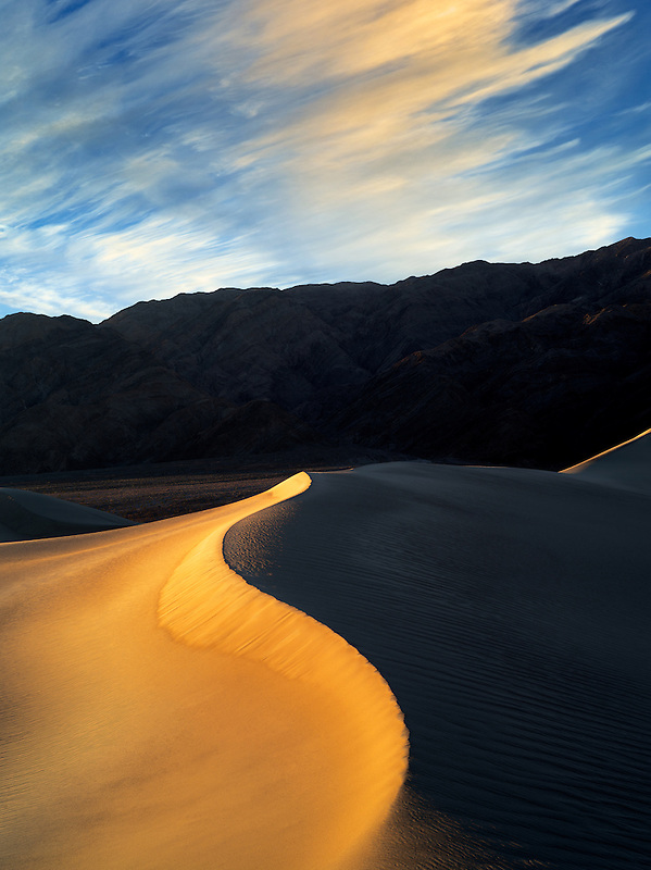 First light on sand dunes. Death Valley National Park, California. Sky has been added