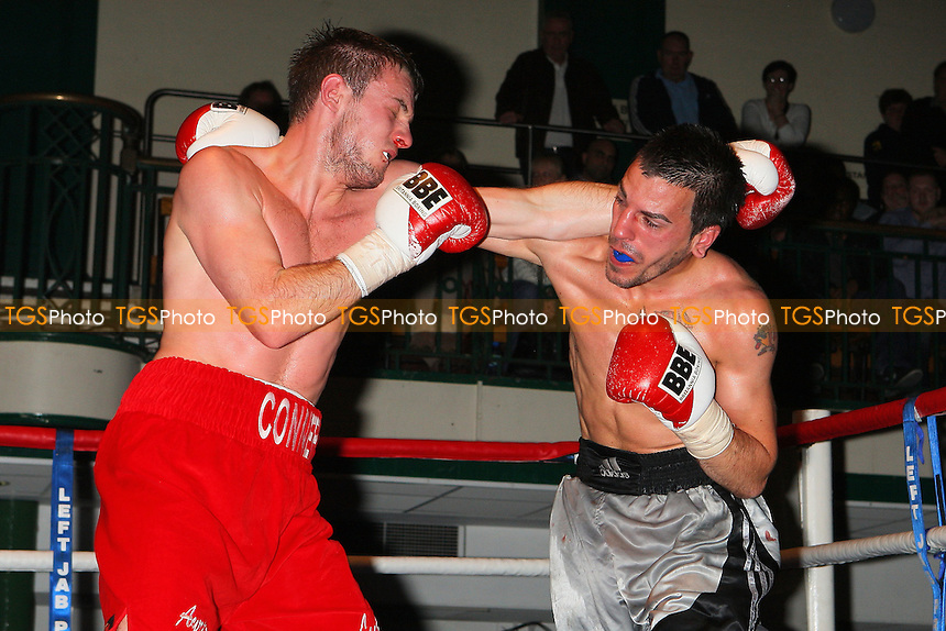 Danny Cassius Connor (red shorts) defeats Russell Pearce in a Welterweight boxing contest at York Hall, Bethnal Green, promoted by Miranda Carter / Left Jab Promotions - 13/11/11 - MANDATORY CREDIT: Gavin Ellis/TGSPHOTO - Self billing applies where appropriate - 0845 094 6026 - contact@tgsphoto.co.uk - NO UNPAID USE.