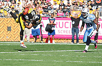 PITTSBURGH, PA - OCTOBER 09:  Hines Ward #86 of the Pittsburgh Steelers dives in for a touchdown in front of Alterraun Verner #20 of the Tennessee Titans during the game on October 9, 2011 at Heinz Field in Pittsburgh, Pennsylvania.  (Photo by Jared Wickerham/Getty Images)
