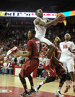 NWA Democrat-Gazette/Michael Woods --02/03/2015--w@NWAMICHAELW... University of Arkansas forward Alandise Harris drives between South Carolina defenders Sindarius Thornwell (0) and Marcus Stroman (1) to score in the first half of Tuesday nights game against the South Carolina Gamecocks at Bud Walton Arena in Fayetteville.