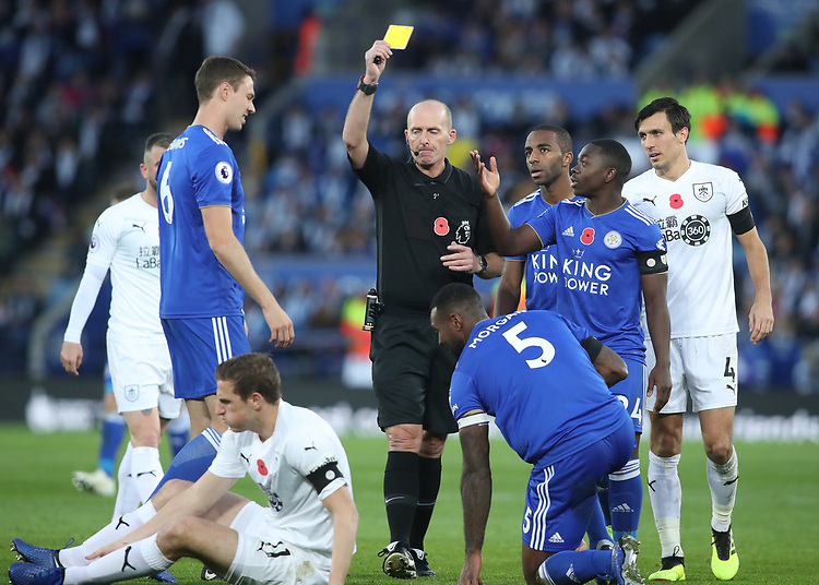 Leicester City's Wes Morgan receives a yellow card<br /> <br /> Photographer Rachel Holborn/CameraSport<br /> <br /> The Premier League - Saturday 10th November 2018 - Leicester City v Burnley - King Power Stadium - Leicester<br /> <br /> World Copyright © 2018 CameraSport. All rights reserved. 43 Linden Ave. Countesthorpe. Leicester. England. LE8 5PG - Tel: +44 (0) 116 277 4147 - admin@camerasport.com - www.camerasport.com