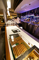 Singapore. Marina Bay Sands. Sky on 57 showcases a modern twist of Franco Asian Cuisine in a setting that offers a birds eye view of Singapore and the bay. Cigars.
