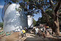 Workers rebuilding the drinking water supply plant for Juba town. Central Equatoria, South Sudan.