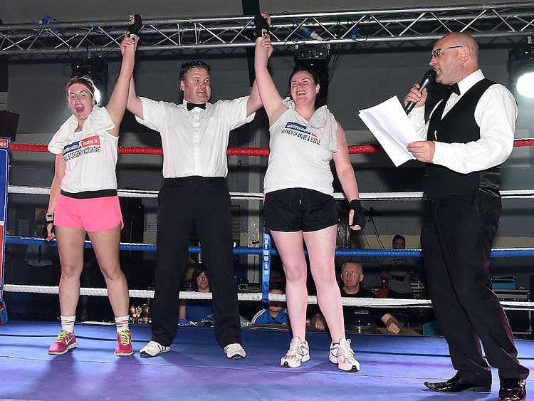 Dara Burke and Clara Carberry fight was a draw in the White Collar Boxing in Ardee Parish Centre. Photo:Colin Bell/pressphotos.ie
