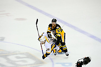 May 29, 2017: Pittsburgh Penguins right wing Carter Rowney (37) checks Nashville Predators right wing Viktor Arvidsson (38) during game one of the National Hockey League Stanley Cup Finals between the Nashville Predators  and the Pittsburgh Penguins, held at PPG Paints Arena, in Pittsburgh, PA. Pittsburgh defeats Nashville 5-3 in regulation time.  Eric Canha/CSM