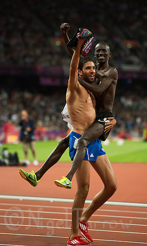 05 AUG 2012 - LONDON, GBR - Ezekiel Kemboi of Kenya (right) celebrates winning the men's 3000m Steeplechase, with Mahiedine Mekhissi-Benabbad (FRA) of France (left) at the London 2012 Olympic Games athletics in the Olympic Stadium in Stratford, London, Great Britain (PHOTO (C) 2012 NIGEL FARROW)