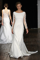 """Model walks runway in an """"Eternity"""" bridal gown from the Alyne by Rita Vinieris Fall 2017 collection on October 7th, 2016 during New York Bridal Fashion Week."""