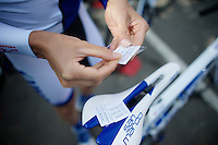 Lucas Euser (USA/United Healthcare) prepping a parcours-sticker for his top-tube<br /> <br /> 79th Fl&egrave;che Wallonne 2015