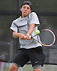 Dylan Granat of Syosset returns a volley during the Nassau County varsity boys' tennis doubles championship match against Sean Mullins and Patrick Hannity of Cold Spring Harbor at Oceanside High School on Satuday, May 16, 2015.<br /> <br /> James Escher
