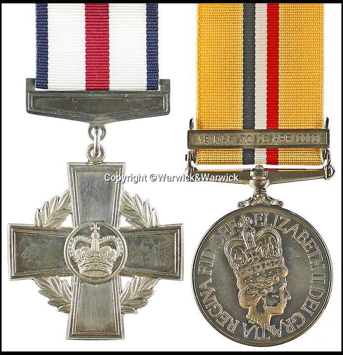 BNPS.co.uk (01202 558833)<br /> Pic: Warwick&amp;Warwick/BNPS<br /> <br /> Robertson's Conspicuous Gallantry Cross(left) and General Service Medal with Northern Ireland clasp.<br /> <br /> An Iraq war hero is selling his &pound;100,000 gallantry medal he won for a notorious battle so he can help get his son on the property ladder.<br /> <br /> Sergeant Gordon Robertson has proudly displayed the Conspicuous Gallantry Cross in his home since he was awarded it following the Battle of Majar al Kabir in which six British Royal Military policemen were killed in 2003.<br /> <br /> He has now decided to sell his decoration - one down from the Victoria Cross - because he wants to help buy his grown-up son his first house.