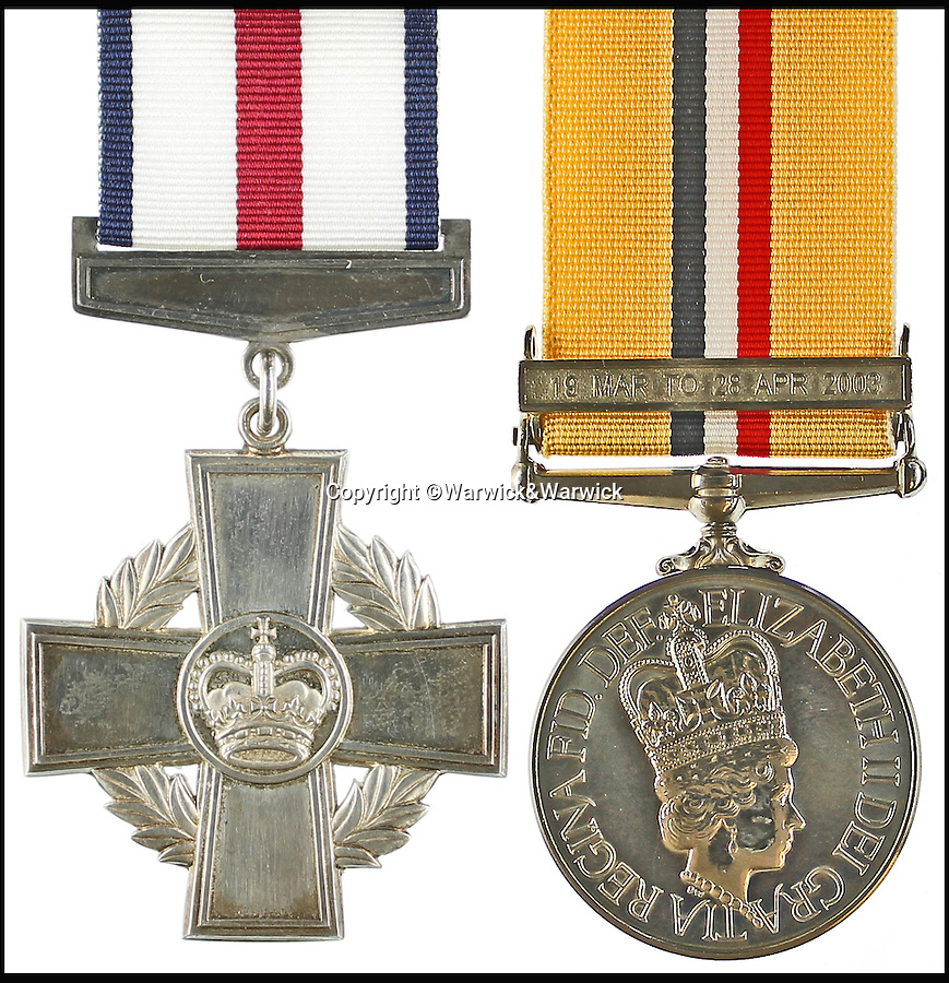 BNPS.co.uk (01202 558833)<br /> Pic: Warwick&Warwick/BNPS<br /> <br /> Robertson's Conspicuous Gallantry Cross(left) and General Service Medal with Northern Ireland clasp.<br /> <br /> An Iraq war hero is selling his £100,000 gallantry medal he won for a notorious battle so he can help get his son on the property ladder.<br /> <br /> Sergeant Gordon Robertson has proudly displayed the Conspicuous Gallantry Cross in his home since he was awarded it following the Battle of Majar al Kabir in which six British Royal Military policemen were killed in 2003.<br /> <br /> He has now decided to sell his decoration - one down from the Victoria Cross - because he wants to help buy his grown-up son his first house.