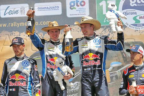 06.03.2016. Leon, Mexico. WRC Rally of Mexico, final stage.  Podium for winners shows Sebastien Ogier (FRA) and Julien Ingrassia (FRA) - Volkswagen Polo R WRC,  Jari-Matti Latvala (FIN) – Miikka Anttila (FIN) Volkswagen Polo R WRC, and Dani Sordo (ESP) – Marc Marti (ESP) - Hyundai i20 WRC