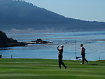 Playing golf at Pebble Beach