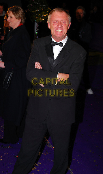 CHRIS TARRANT.British Comedy Awards 2006, London Television Studios, London, UK. .December 13th, 2006.full length black tuxedo arms crossed.CAP/CAN.©Can Nguyen/Capital Pictures