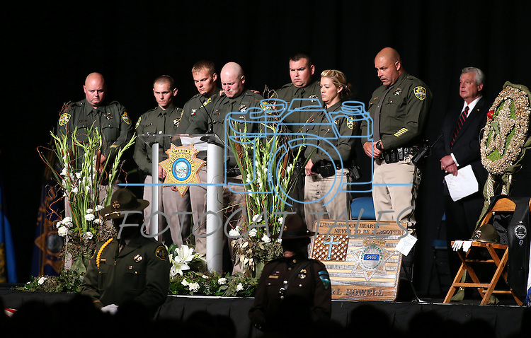 Friends and coworkers, including Dep. Dan Jones, center, say farewell to Carson City Sheriff's Deputy Carl Howell during a memorial service in Reno, Nev., on Thursday, Aug. 20, 2015. Howell was shot and killed early Saturday morning after responding to a domestic violence call. (Cathleen Allison/Las Vegas Review-Journal)