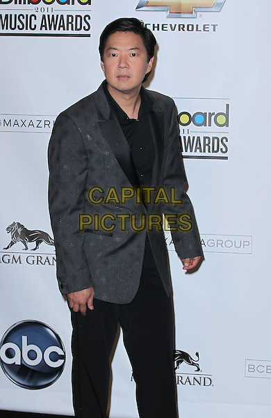KEN JEONG.The 2011 Billboard Music Awards Pressroom held at the MGM Grand Garden Arena, Las Vegas, Nevada, USA..May 22nd, 2011.half 3/4 length black trousers grey gray suit jacket .CAP/ADM/MJT.© MJT/AdMedia/Capital Pictures.