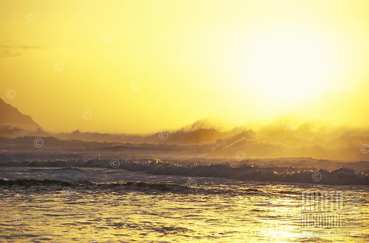Sunset with large waves crashing, Kee beach, north shore of island of Kauai