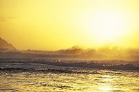 Sunset with large waves crashing, Kee beach, north shore of island of Kauai