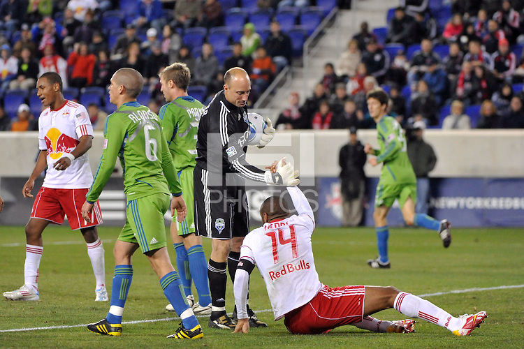 Seattle Sounders goalkeeper Kasey Keller (18) helps up Thierry Henry (14) of the New York Red Bulls. The New York Red Bulls defeated the Seattle Sounders 1-0 during a Major League Soccer (MLS) match at Red Bull Arena in Harrison, NJ, on March 19, 2011.