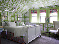 The bed valance and blinds in a guest bedroom are of a China Seas cotton and the carpet is by Shyam Ahja. The bold green and white bamboo wallpaper is original to the house