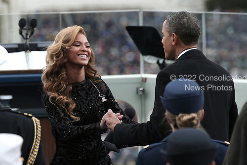 United States President Barack Obama greets singer Beyonce after she performs the National Anthem during the public ceremonial inauguration on the West Front of the U.S. Capitol January 21, 2013 in Washington, DC.   Barack Obama was re-elected for a second term as President of the United States.       .Credit: Win McNamee / Pool via CNP