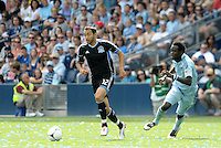San Jose defender Ramiro Corrales (12) goes past Kei Kamara... Sporting Kansas City defeated San Jose Earthquakes 2-1 at LIVESTRONG Sporting Park, Kansas City, Kansas.