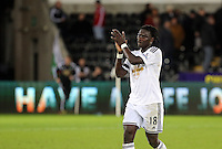 Pictured: Bafetimbi Gomis of Swansea thanks home supporters at the end of the game Saturday 10 January 2015<br />