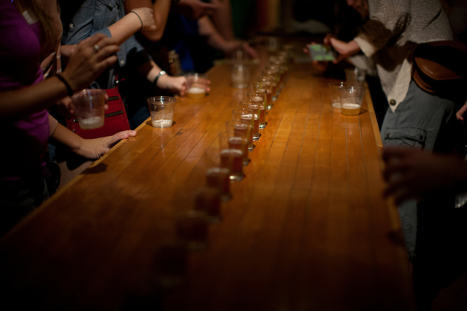 """Samples of Crosshare, a Double IPA, sit on a bar for """"beer school"""" participants to sample during a tour of Big Woods Brewing Company in Nashville, Ind. on Saturday, Sept. 6, 2014. (Photo by James Brosher)"""