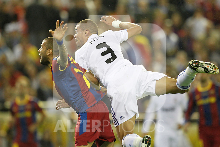 Real Madrid's Pepe and FC Barcelona's Daniel Alves during la Spain King's Cup Final match in Valencia, Spain on April 20th 2011...Photo: Cesar Cebolla / ALFAQUI