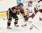 Paige Savage (NU - 28), Lexi Bender (BC - 21) - The Boston College Eagles defeated the Northeastern University Huskies 5-1 (EN) in their NCAA Quarterfinal on Saturday, March 12, 2016, at Kelley Rink in Conte Forum in Boston, Massachusetts.