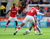 Lincoln City's Joe Morrell vies for possession with Rotherham United's Carlton Morris<br /> <br /> Photographer Chris Vaughan/CameraSport<br /> <br /> The EFL Sky Bet Championship - Rotherham United v Lincoln City - Saturday 10th August 2019 - New York Stadium - Rotherham<br /> <br /> World Copyright © 2019 CameraSport. All rights reserved. 43 Linden Ave. Countesthorpe. Leicester. England. LE8 5PG - Tel: +44 (0) 116 277 4147 - admin@camerasport.com - www.camerasport.com