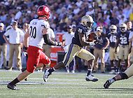 Annapolis, MD - September 23, 2017: Navy Midshipmen running back Josh Brown (28) runs the ball during the game between Cincinnati and Navy at  Navy-Marine Corps Memorial Stadium in Annapolis, MD.   (Photo by Elliott Brown/Media Images International)