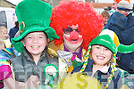 DELIGHT: Niamh Murphy and Shauna Kerins meet Krusty the Clown at the Milltown St Patricks Day Parade on Saturday..