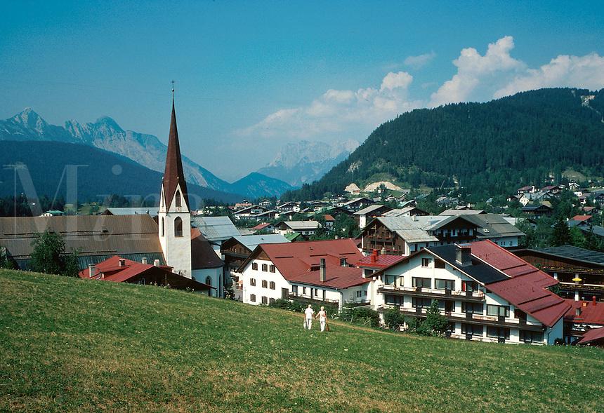 Seefeld, Austria. traditional red-tile roof architecture, church steeple. Seefeld Tyrol Austria.